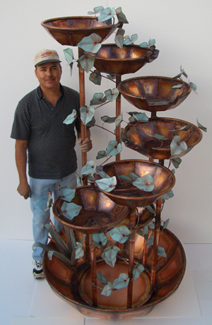 Roberto Marquez with a 7-bowl 7-Foot Waterfall Fountain