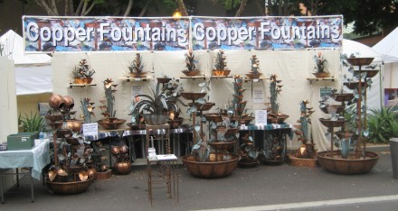 Here is what my booth looks like. You can see my copper water fountains range in size from desktop size to 7' tall.